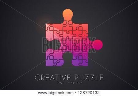 Puzzle logo. Creative logo of puzzle pieces. Color puzzle
