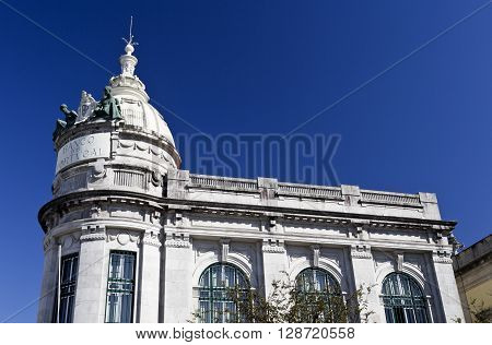 BRAGA, PORTUGAL - September 21, 2015: Detail of the upper level and dome of the building of the Bank of Portugal (written on the image), on September 21, 2015 in Braga, Portugal
