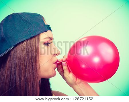 Teen Girl Blowing Red Balloon.