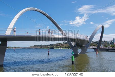 PERTH,WA,AUSTRALIA-APRIL 10,2016: Suspension bridge over the Swan River with tourists at Elizabeth Quay in Perth, Westenr Australia.