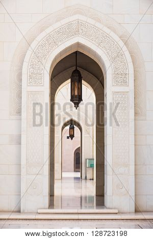 Gates surrounded by scriptures from the Quran at Sultan Qaboos Grand Mosque in Muscat the main mosque of The Sultanate of Oman.