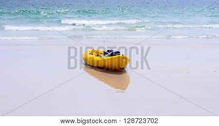 Colorful yellow kayaks on beach Thailand. Colorful yellow kayaks
