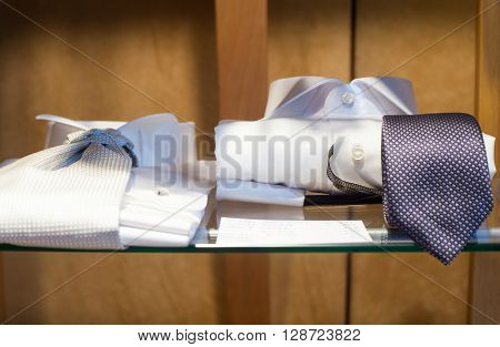 Close uo of white male shirts and necktie