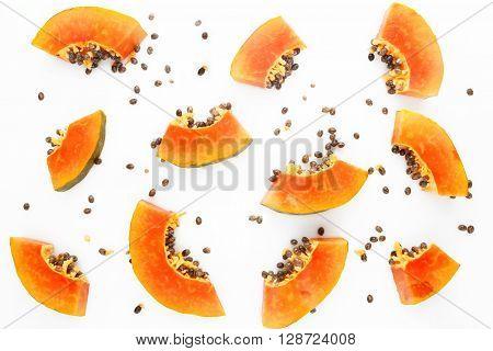 Papaya fruit background - top view - on the white