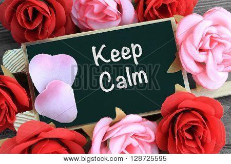 keep calm message, text on a chalkboard