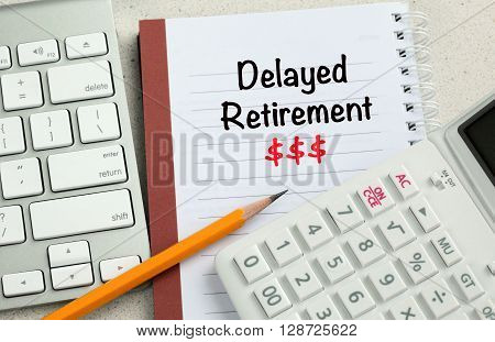 concept of delayed retirement with money sign and calculator