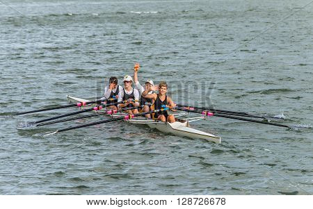 Sydney Australia - November 10 2014: Rowing team rowing scull on the Parramatta River Sydney suburb New South Wales Australia.