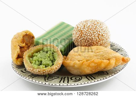 Plate full of asian traditional dessert or snack on white background