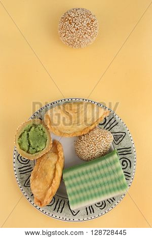 Asian traditional dessert, snack on yellow background