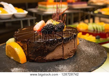 Triple mousse chocolate cake on buffet dessert