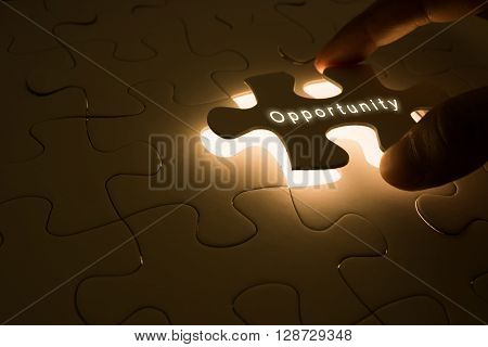 opportunity concept with hand opening the puzzle