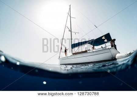 Young people on a yacht at sea