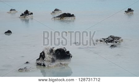 Small rocks at the Blue lagoon lake at Reykjanes Peninsula in Iceland