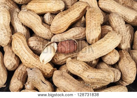 background of fruits of groundnut close up.