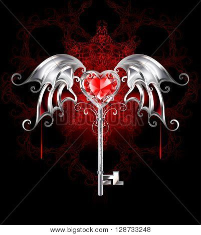 jewelry silver key with a ruby heart vampire and silver wings on a dark patterned background. Gothick style.
