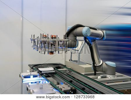 Industrial robot working in factory,Conveyor Tracking Controler of robotic hand.