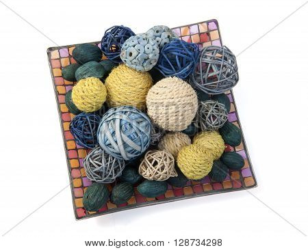 Medley decor with colorful balls in the barrel isolated on white