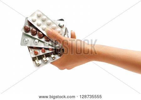 Woman's hand holding pills plates isolated on white background. Close up. High resolution product. Healthcare concept