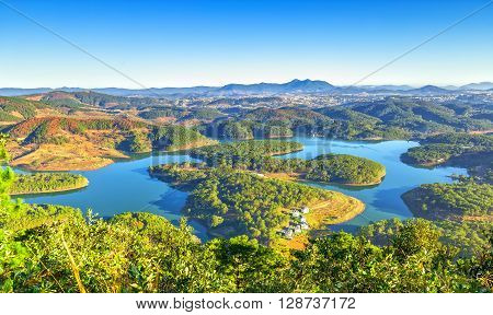 Da lat plateau with yellow sunshine early, lake, winding hill as reservoirs for the city Da lat, Lam Dong, Vietnam