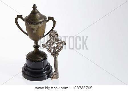 key with tassel and trophy