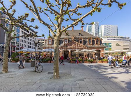 People Enjoy The Sunny Day In Frankfurt At Cafe Hauptwache