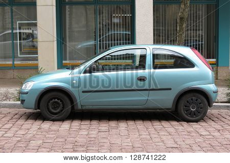 KOETHEN GERMANY - CIRCA MARCH 2016: blue Opel Corsa Swing parked on the street