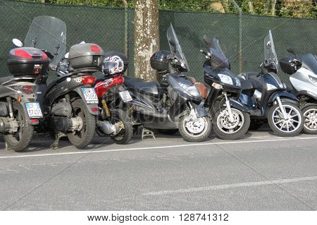 SIENA ITALY - CIRCA APRIL 2016: Motorbicycles parked on a street in the city centre