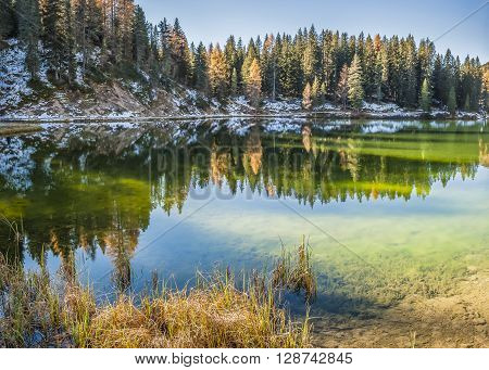 Autumn Landscape With Lake, Mountain And Reflection