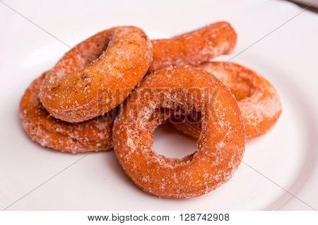 Image of small donuts on white plate
