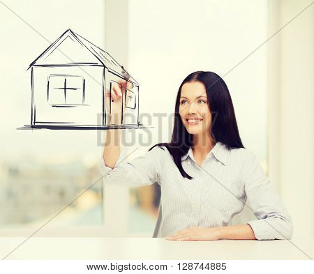 real estate, accomodation and technology concept - smiling woman drawing house on virtual screen