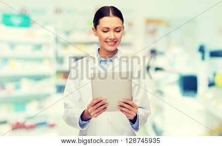 medicine, pharmacy, people, health care and pharmacology concept - smiling female doctor with tablet pc computer over drugstore background