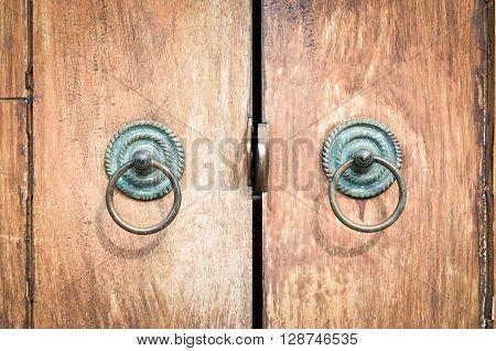 Old chinese style door handles on brown wooden door