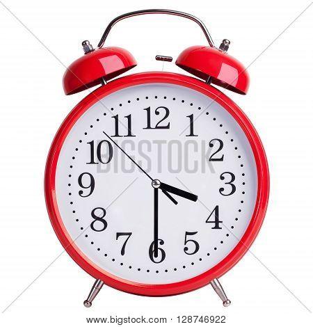 Round red alarm clock shows half past three