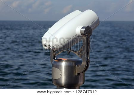 Coin Operated Tower Viewer Binoculars on a Stalk Near Sea
