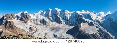 Stunning view of the Bernina massive and Morteratsch glacier at the top of Munt Pers near Diavolezza in Engadin area of Switzerland.
