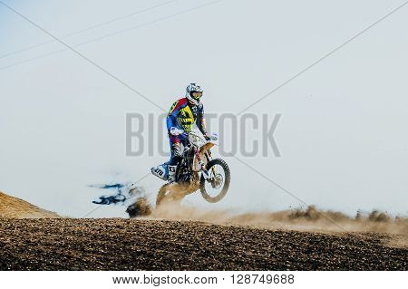 Miasskoe Russia - May 02 2016: racer on a motorcycle rides on rear wheel on a dusty track during Cup of Urals motocross