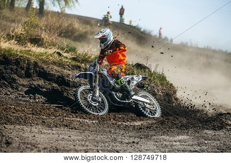 Miasskoe Russia - May 02 2016: racer on a motorcycle skid on turn on a dusty race track during Cup of Urals motocross