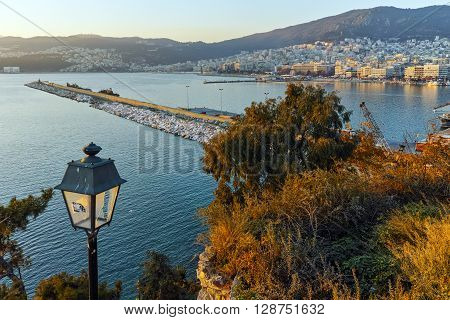 Last rays of sun over city of Kavala, East Macedonia and Thrace, Greece