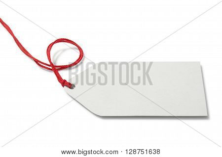 Blank price tag with cord on white background