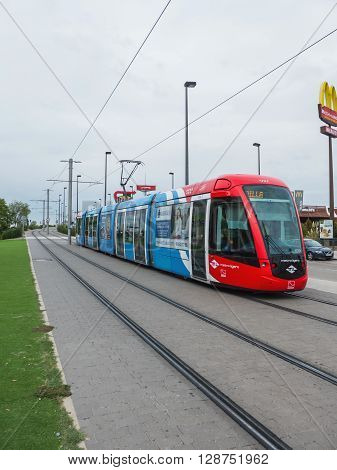 MADRID SPAIN - OCTOBER 3 2015: new modern tramway on rails also known as Metro Ligero