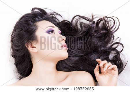 Side View Of Model Portrait With Black Hair Over White