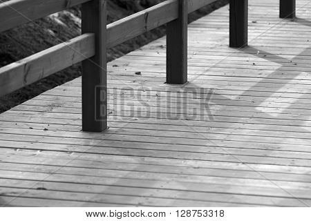 design of the wooden floor or platform with a handrail closeup and blank space