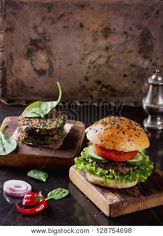 Veggie quinoa burgers with  lettuce, tomato and spinach
