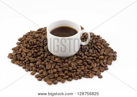 mug of coffee on a background coffee beans scattered