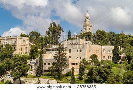 JERUSALEM ISRAEL - APRIL 4: The Dormition Abbey and the Institute for the Study of the Bible outside the walls of the Old City in Jerusalem Israel on April 4 2015