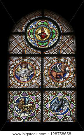 OBERSTAUFEN, GERMANY - OCTOBER 20: Symbols of the Evangelists, stained glass window in the parish church of St. Peter and Paul in Oberstaufen, Germany on October 20, 2014.