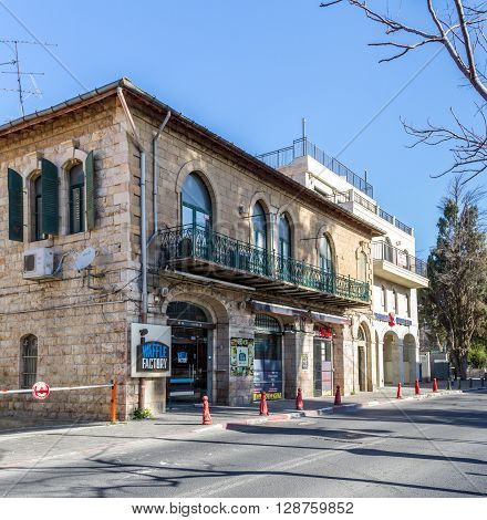 JERUSALEM ISRAEL - FEBRUARY 27: Mediterranean urban landscape - Stone house with arched windows faced with white stone in Jerusalem Israel on February 27 2016