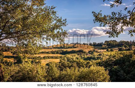 Tuscan country landscape. Summer over tuscan hills.