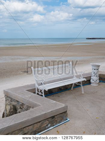 Bench in front of the beach and sea