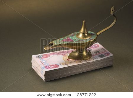 'Dream come true' - an idea. Alladdin lamp and hard cash - a metaphor.